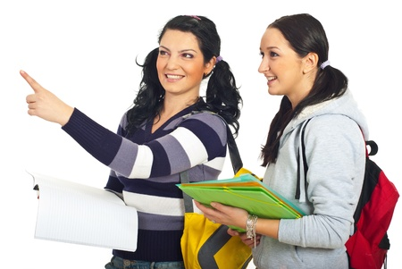 Student woman pointing away and showing something to her colleague isolated on white background photo