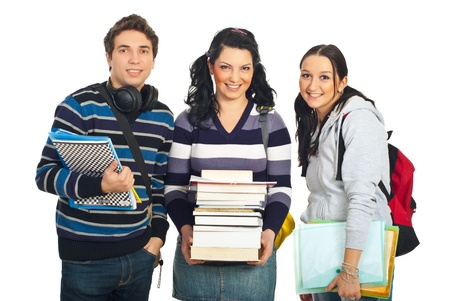 Happy team of three students with books and notebooks standing in a row isolated on white background photo