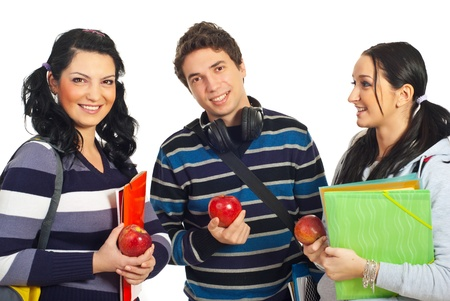 Healthy team of three students holding apples and notebooks isolated on white background Stock Photo - 8586406