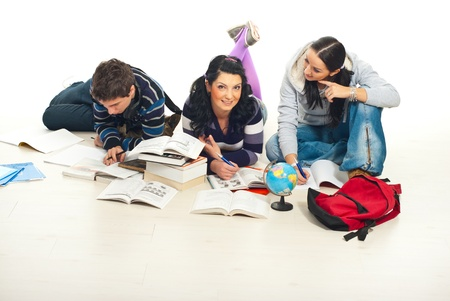 Three students learning together and doing their homework home  photo