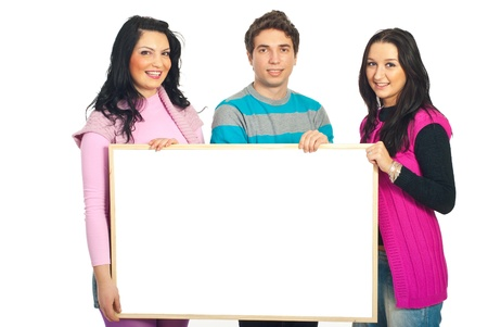 Smiling casual team of three friends holding a blank banner isolated on white background Stock Photo - 8585785