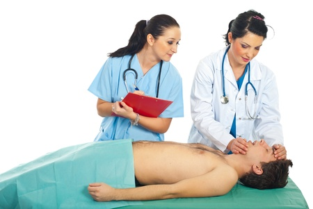 cardiopulmonary: Doctor woman teaching a student female to make resuscitation on patient male
