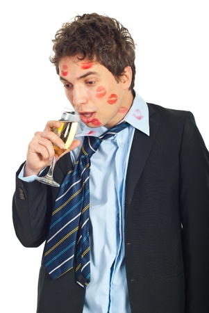 cheating: Drunk kissed man in businerss suit drinking glass of wine isolated on white background