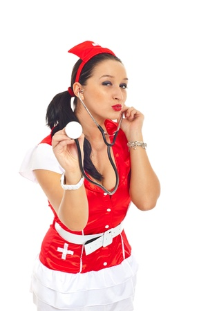 Beautiful sensual nurse in sexy uniform holding a stethoscope and sending kisses isolated on white background Stock Photo - 8585725