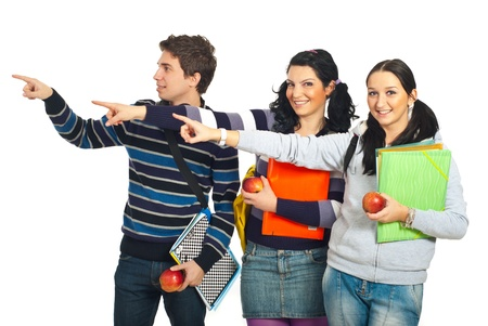 Group of three students in a row pointing to copy space left side isolated on white background