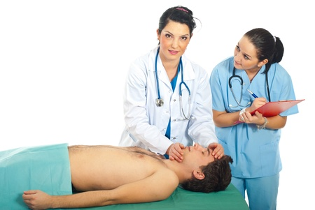 resuscitation: Teacher doctor prepare for resuscitation lesson on male patient  and her student female being attentive to her  Stock Photo