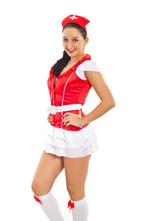Beautiful sensual nurse in sexy uniform posing over white background Stock Photo - 8586853