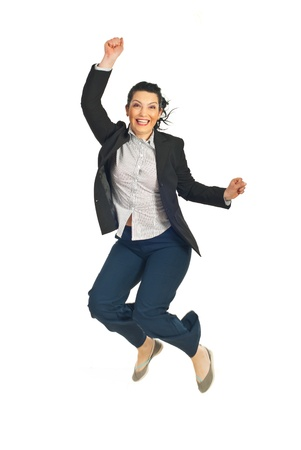 young cheering: Successful business woman jumping with raised fists and cheering isolated on white background Stock Photo