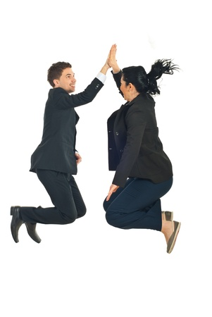 Two business people jumping and giving high five in the air isolated on white background photo