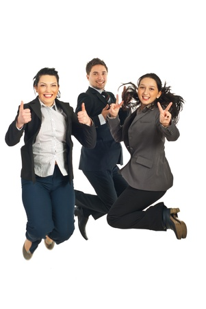 Three business people jumping  giving thumbs up and showing victory sign isolated on white background photo