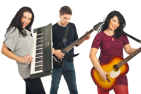 Cheerful musical band of three persons playing guitars and organ isolated on white background photo