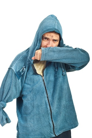 dungy: Beggar man with handicap wipe his nose with sleeve Stock Photo