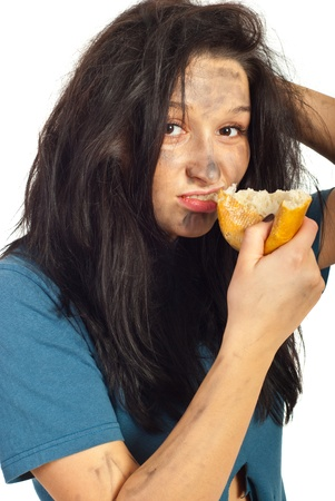 dungy: Portrait of beggar girl eating piece of bread  and looking camera isolated on white background