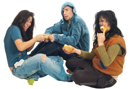 humiliated: Hungry three beggars fight for a bread and sitting down isolated on white background