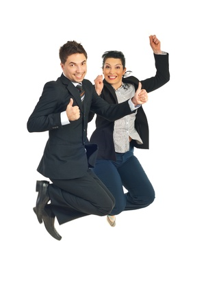 Two successful busienss people jumping and giving thumbs up isolated on white background photo