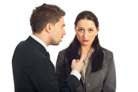 Nervous boss argue nd pointing to a sad employer woman isolated on white background photo