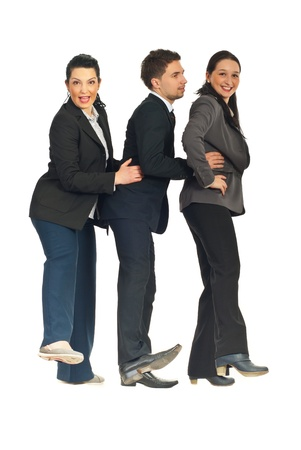 Successful business people standing in a row and dancing isolated on white background photo