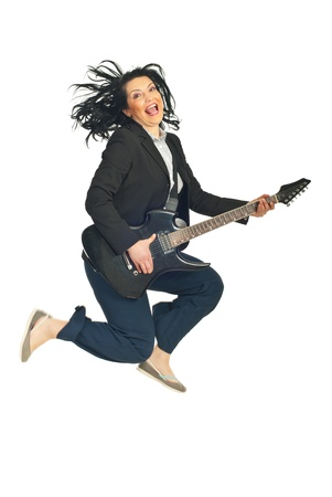 Energy business woman  jumping and singing with quitar isolated on white background photo