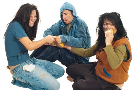 beggars: Three beggars sharing a bread and  eating isolated on white background