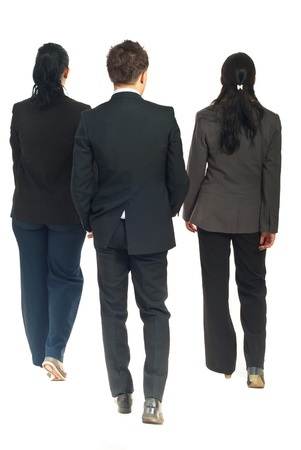 people walking white background: Back of three business people walking isolated on white background