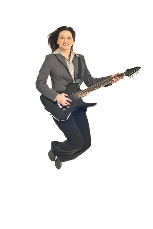 Executive woman jumping with guitar isolated on white background photo