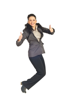 Business woman jumping and giving thumbs up isolated on white background photo