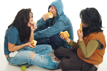 smutty: Three beggars sitting , sharing a bread and eating together Stock Photo