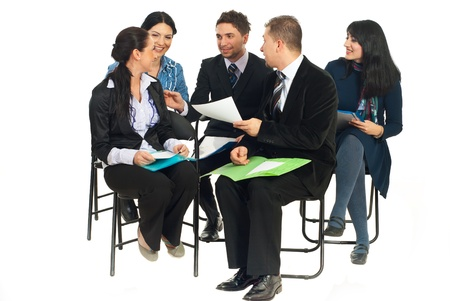 discussion group: Happy team of five business people sitting on chairs and having funny conversation at seminar isolated on white background