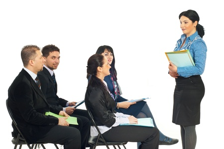 business attire teacher: Four business people at training seminar with teacher making conversation with one of the business woman  isolated on white background Stock Photo