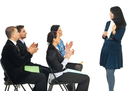 Business woman showing her successful work paper and her colleagues congratulate by applause in a training classroom photo