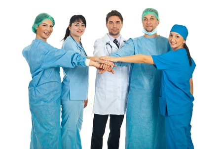 United doctors team standing with theur hands on top each other isolated on white background photo