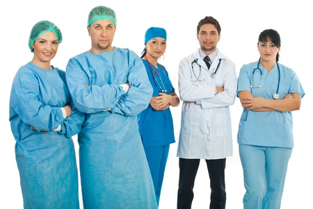 Two surgeons team standing with arms folded in front of camera and other team of doctors standing same in background photo