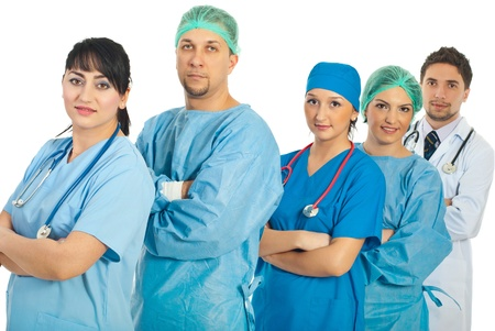 Group of differenthospital doctors standing in a row with arms folded isolated on white background Stock Photo - 8691926