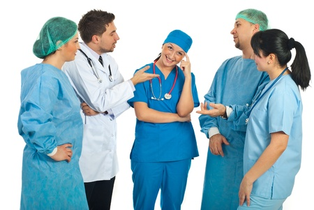 explanations: Four doctors asks for  explanations to a nurse or a colleague doctor and she smiling and thinking isolated on white background