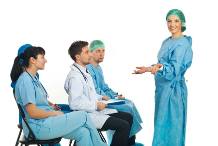 Confused surgeon woman dont know what to do at seminar and her colleagues being surprised about her attitude photo