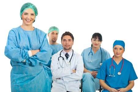 Surgeon woman teacher standing with arms folded in front of camera while  four medical students sitting on chairs  photo