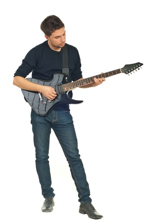 playing instrument: Full length of young man playing guitar isolated on white background
