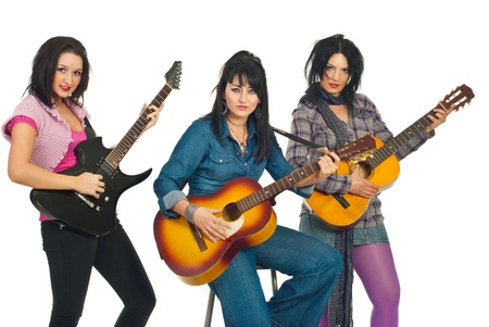 Band of three attractive women playing electronic and acoustic guitars isolated on white background Stock Photo - 8691952