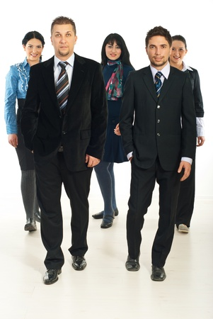 Team of five business people with men in front of image walking photo