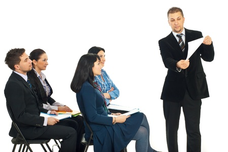 Business man showing paperwork at seminar and the team of people looking attentive to his presentation photo