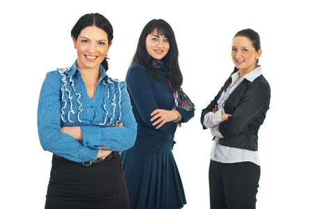 Attractive business woman  standing with arms folded in front of camera and her team of women smiling in background Stock Photo - 8691992