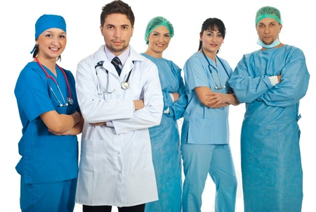 Two teams of young adults doctors and mid  adults doctors standing with arms folded isolated on white background Stock Photo - 8692062