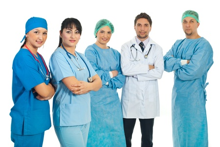 Two healthcare worlers women standing with arms folded in front of image and other team of doctors in background photo