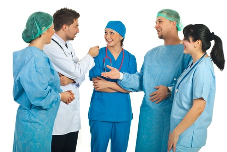 doctors and nurses: Cheerful team of five different doctors having conversation and laughing isolated on white background Stock Photo