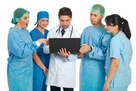 Team of doctors searching on a laptop and one of doctors women being surprised  photo