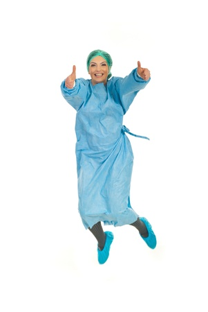 ecstatic: Successful surgeon woman in uniform jumping and giving thumbs up isolated on white background