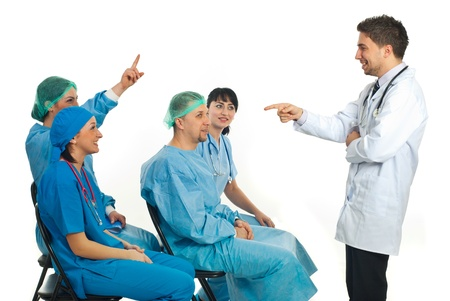 Doctor teacher asking a doctor woman a question but other doctor woman know the answer and raising hand in a classroom of doctors or seminar Stock Photo - 8692058