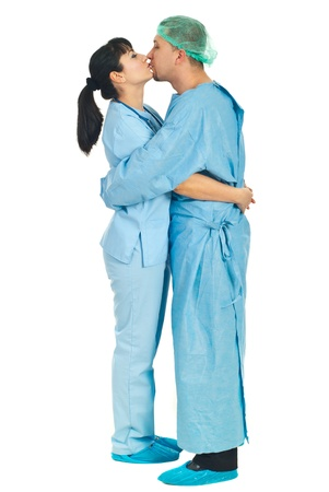 Full length of couple of  doctors in uniforms  kissing  isolated on white background photo
