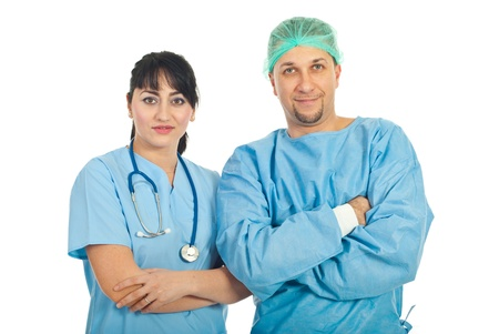 Team of two doctors standing with arms folded isolated on white background photo