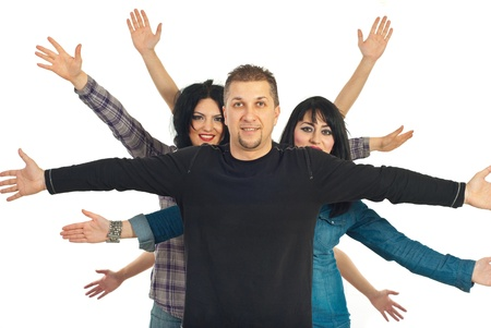Happy cheerful friends standing with  hands up behind a mid adult man isolated on white background photo